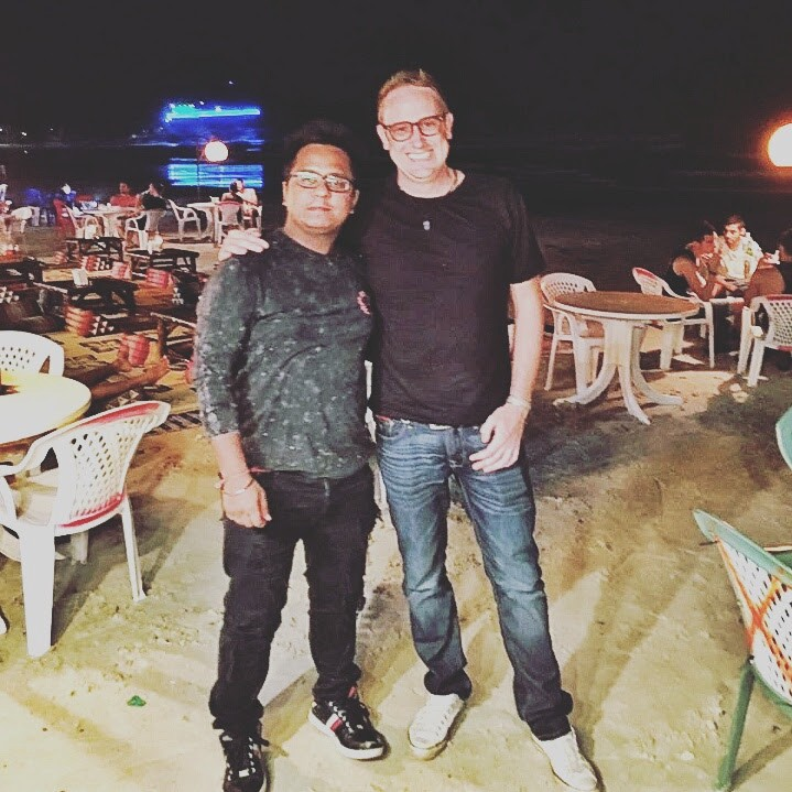 Nik, here with the head of his research team in India